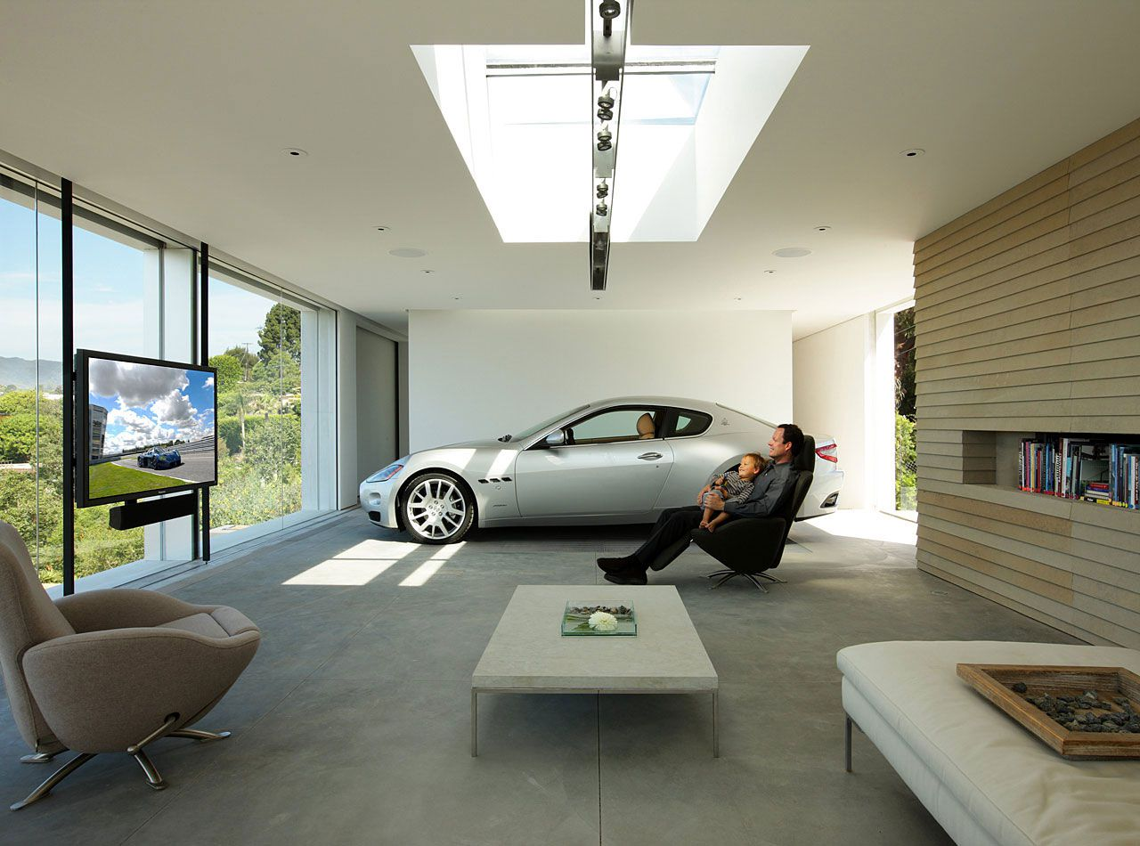 Toys for boys dream garage for a dream car caandesign for Design moderno garage per auto
