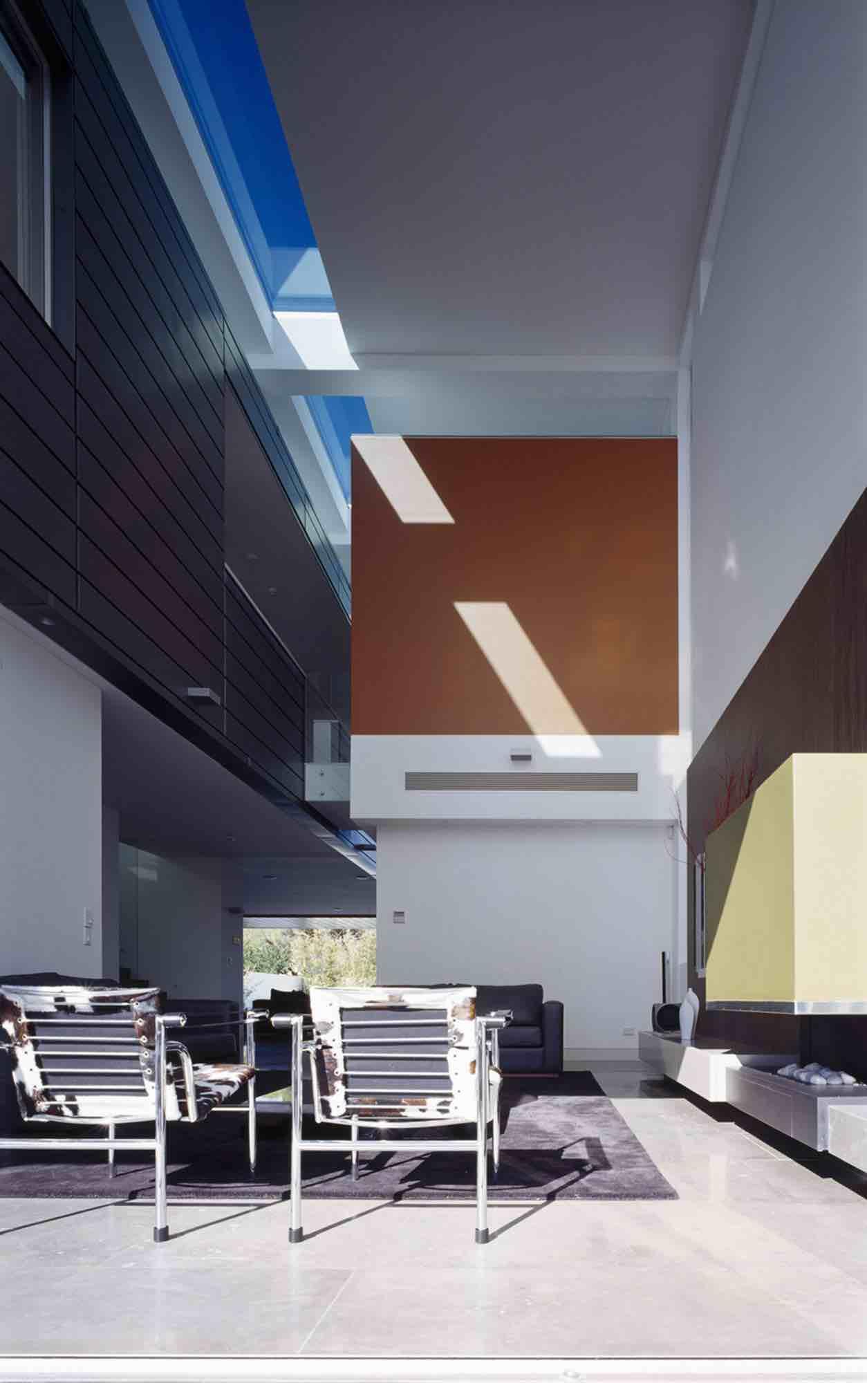 minosa-design-high-voids-sitting-room-modern-custom-joinery-gas-fireplace-limestone-floor-01