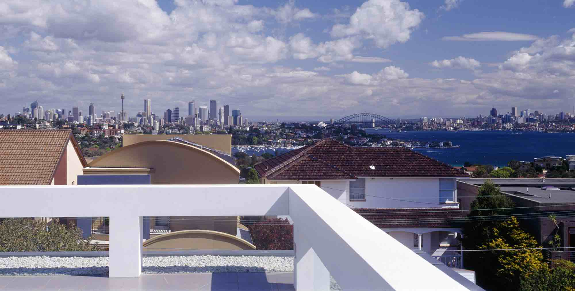 minosa-design-high-voids-sitting-room-modern-custom-joinery-gas-fireplace-limestone-floor-sydney-skyline-view-01