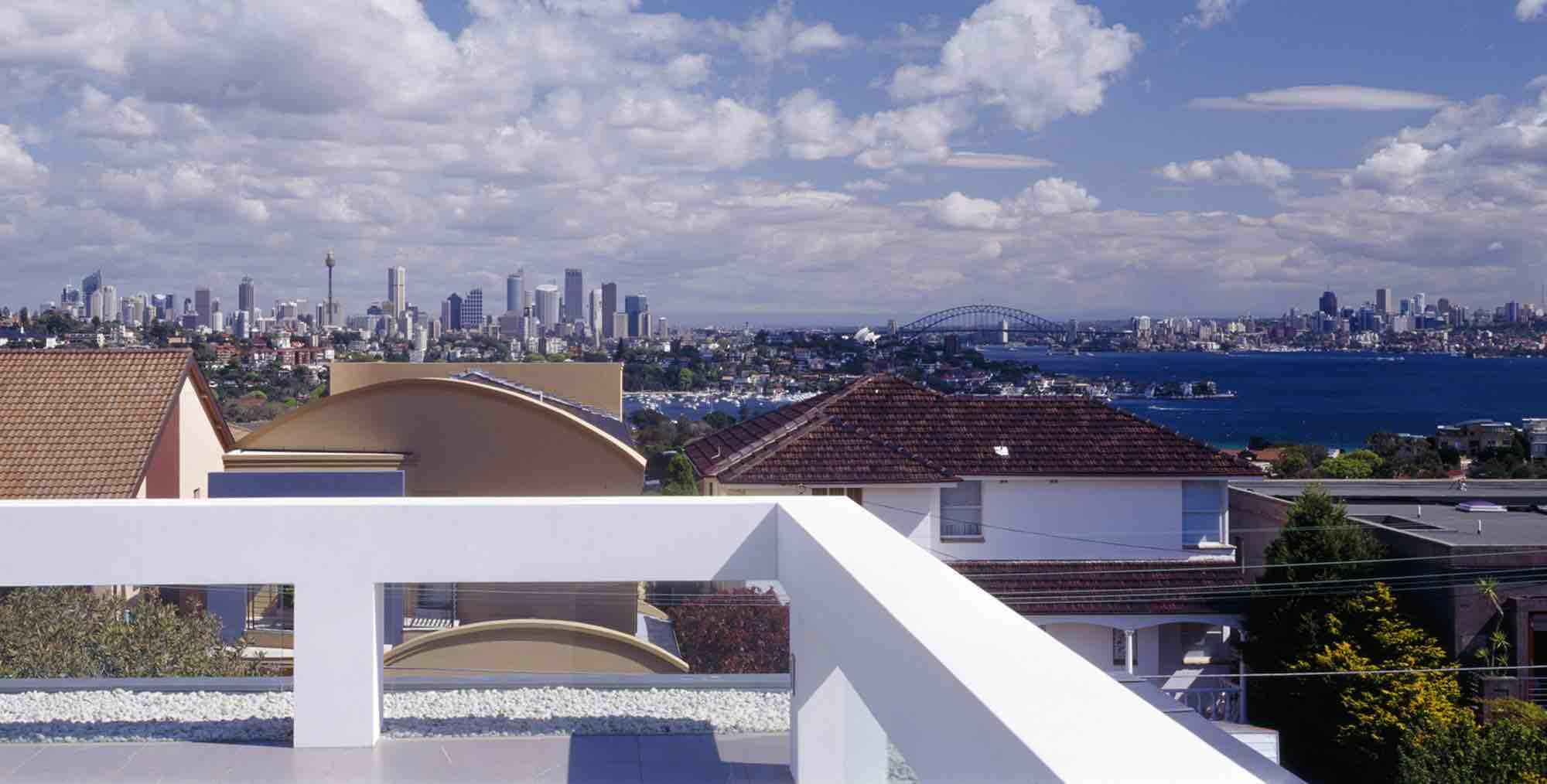 minosa-design-high-voids-sitting-room-modern-custom-joinery-gas-fireplace-limestone-floor-sydney-skyline-view-01