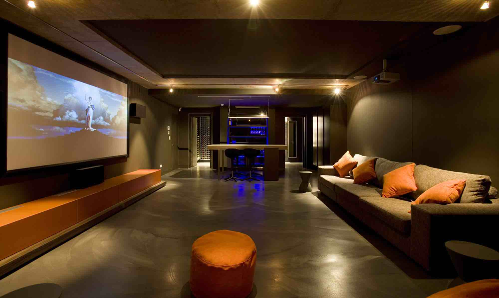 minosa-design-home-theatre-design-dark-kitchenette-led-exposed-orange-concrete-0