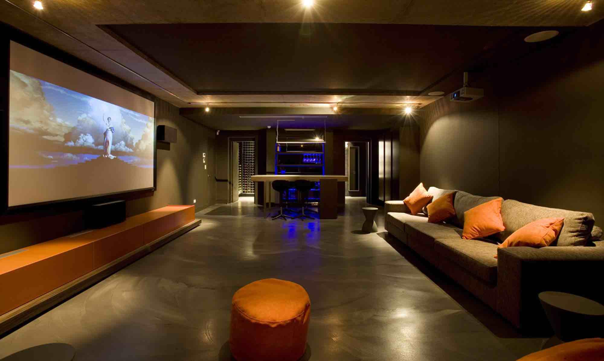 minosa-design-home-theatre-design-dark-kitchenette-led-exposed-orange-concrete-0