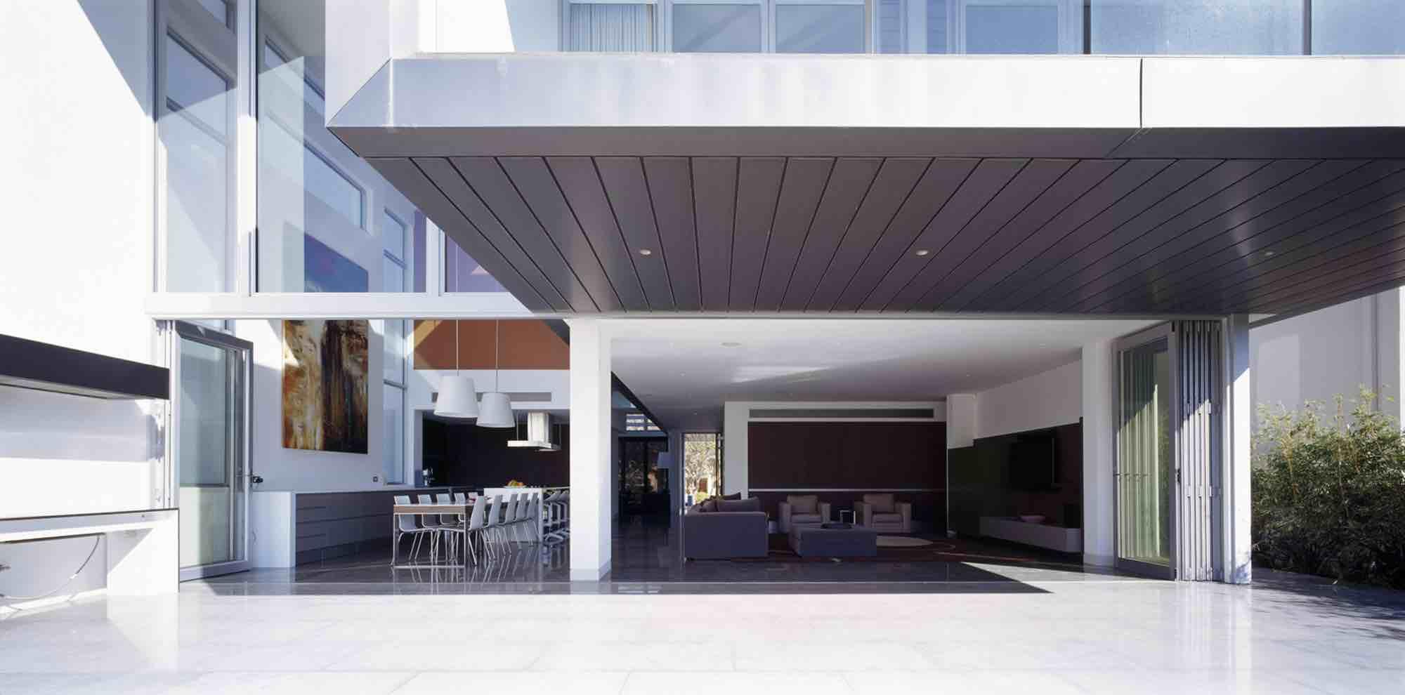 minosa-design-open-plan-high-ceiling-void-large-dinning-table-corian-benchtop-minosa-kitchen-gilda-cantilever-03