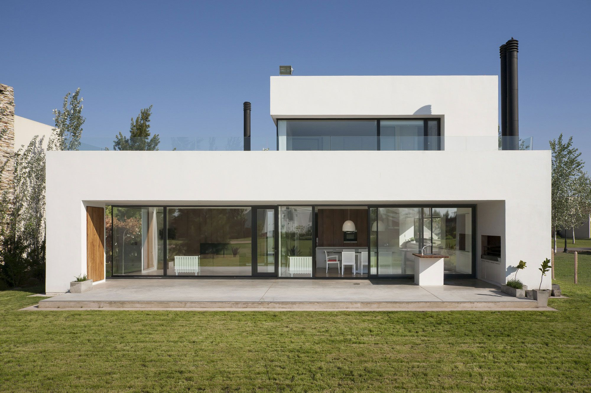 Casa mc golf club by vismaracorsi arquitectos caandesign for Casa minimalista 120m2