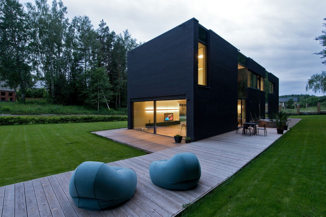Black boxed family house in minsk by architectural bureau g