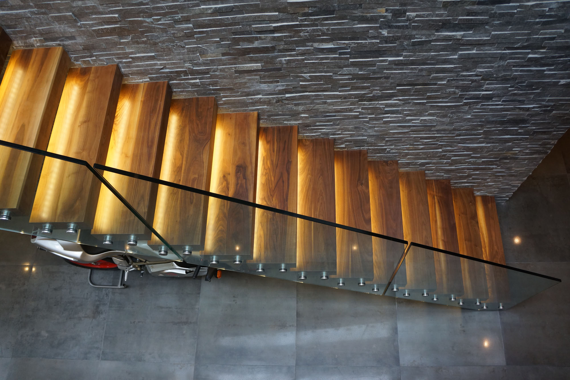 wood and glass staircase seen form above