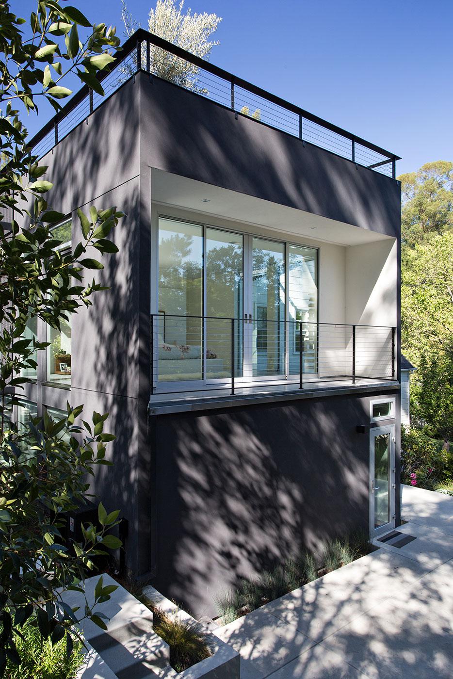Minimal Modern Addition Home with Dark Grey Stuccoed Walls by Klopf Architecture-03