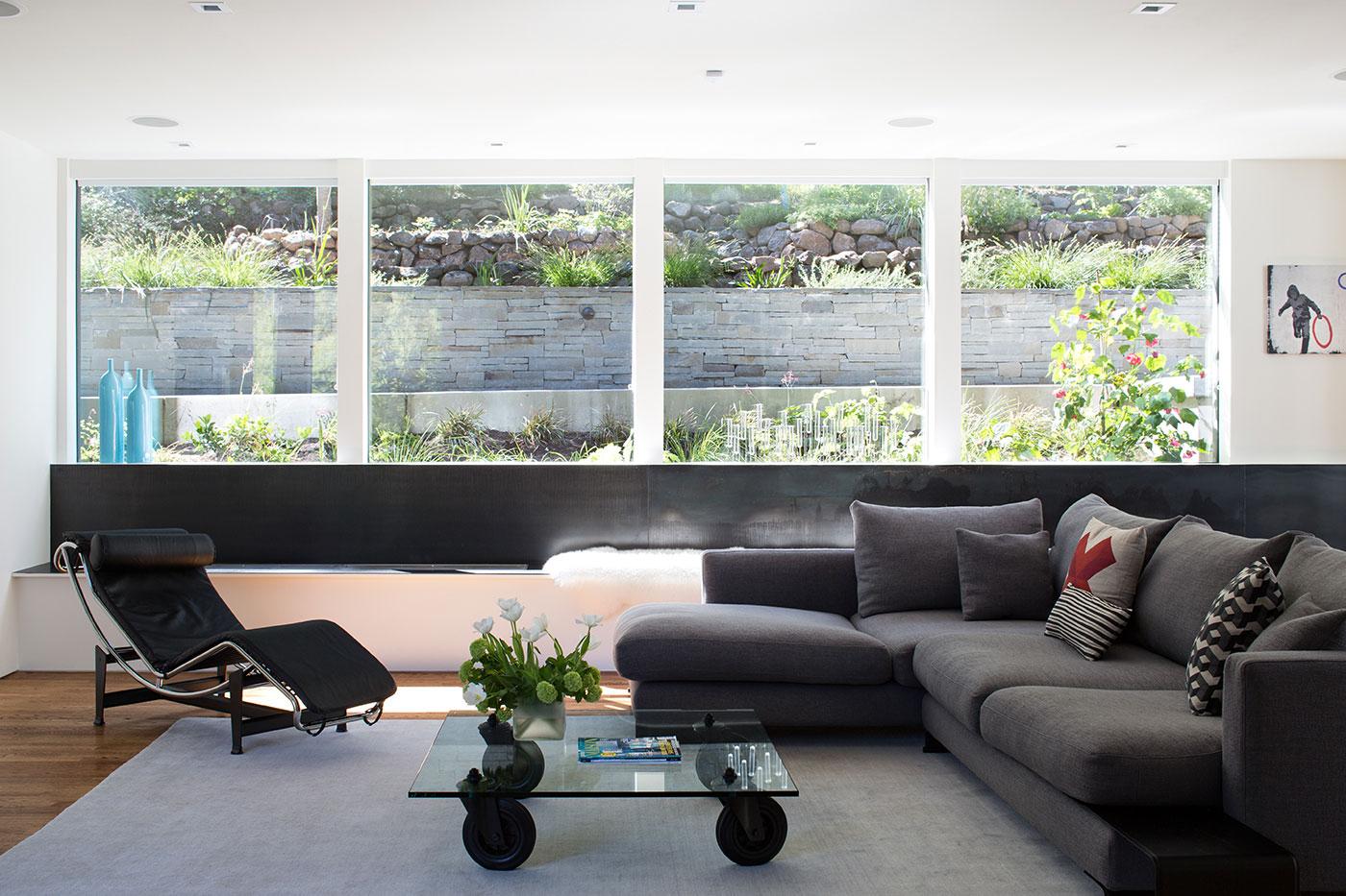 Minimal Modern Addition Home with Dark Grey Stuccoed Walls by Klopf Architecture-09