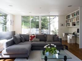 Minimal Modern Addition Home with Dark Grey Stuccoed Walls by Klopf Architecture