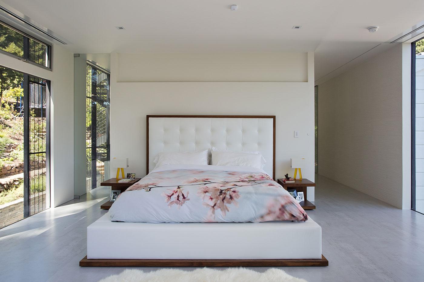 Minimal Modern Addition Home with Dark Grey Stuccoed Walls by Klopf Architecture-12