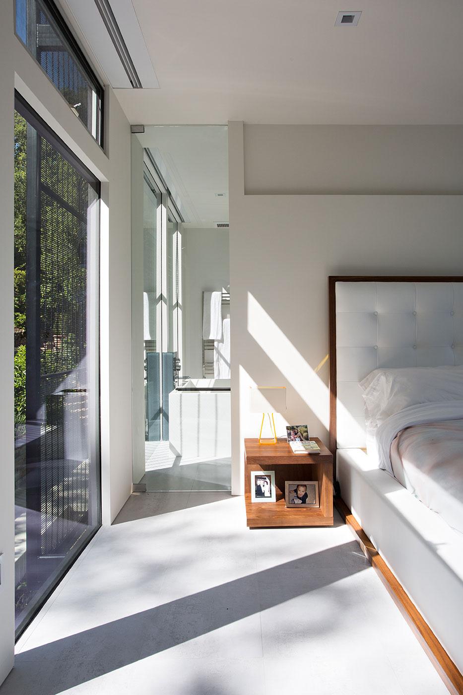 Minimal Modern Addition Home with Dark Grey Stuccoed Walls by Klopf Architecture-15