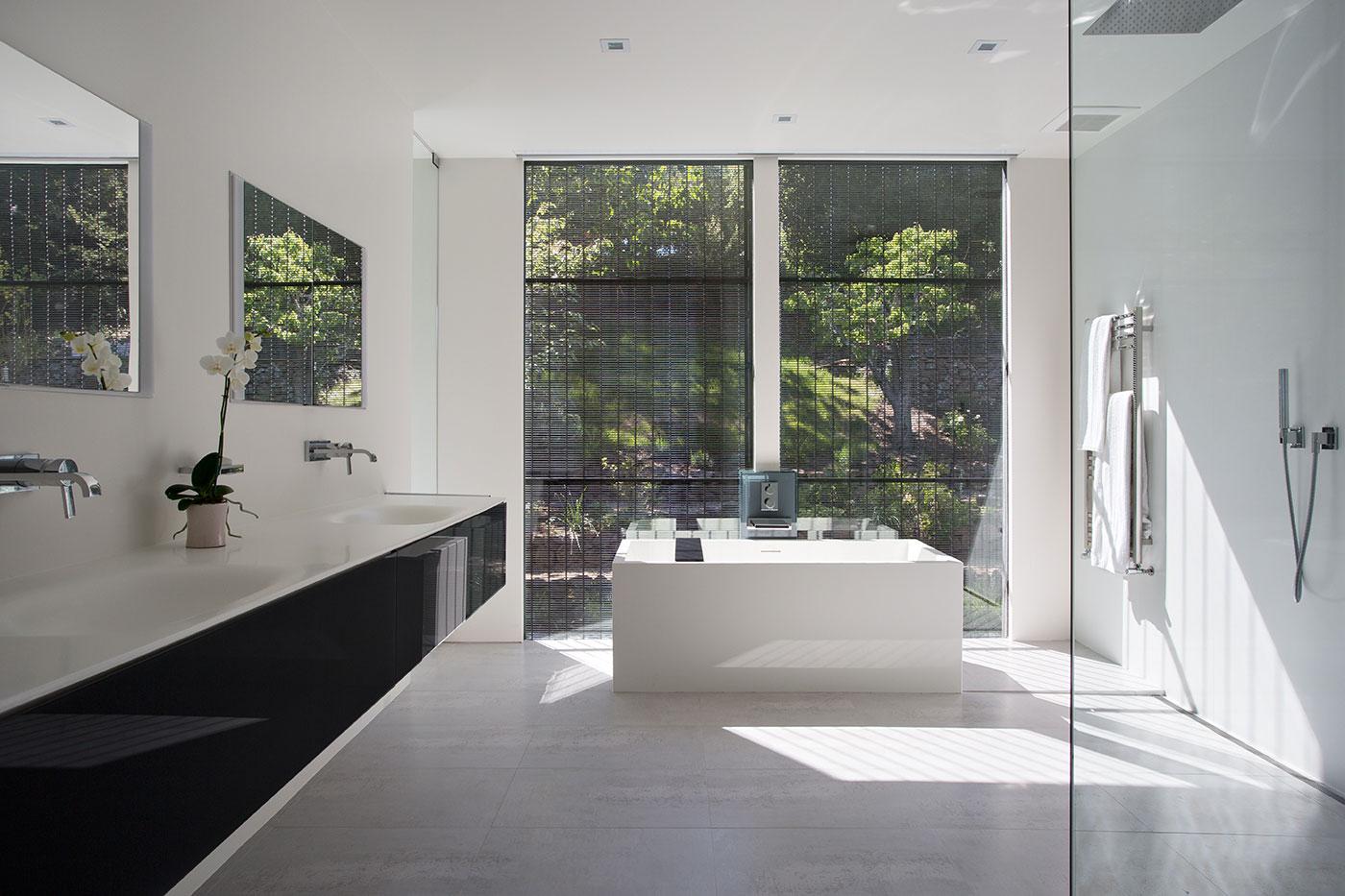 Minimal Modern Addition Home with Dark Grey Stuccoed Walls by Klopf Architecture-18