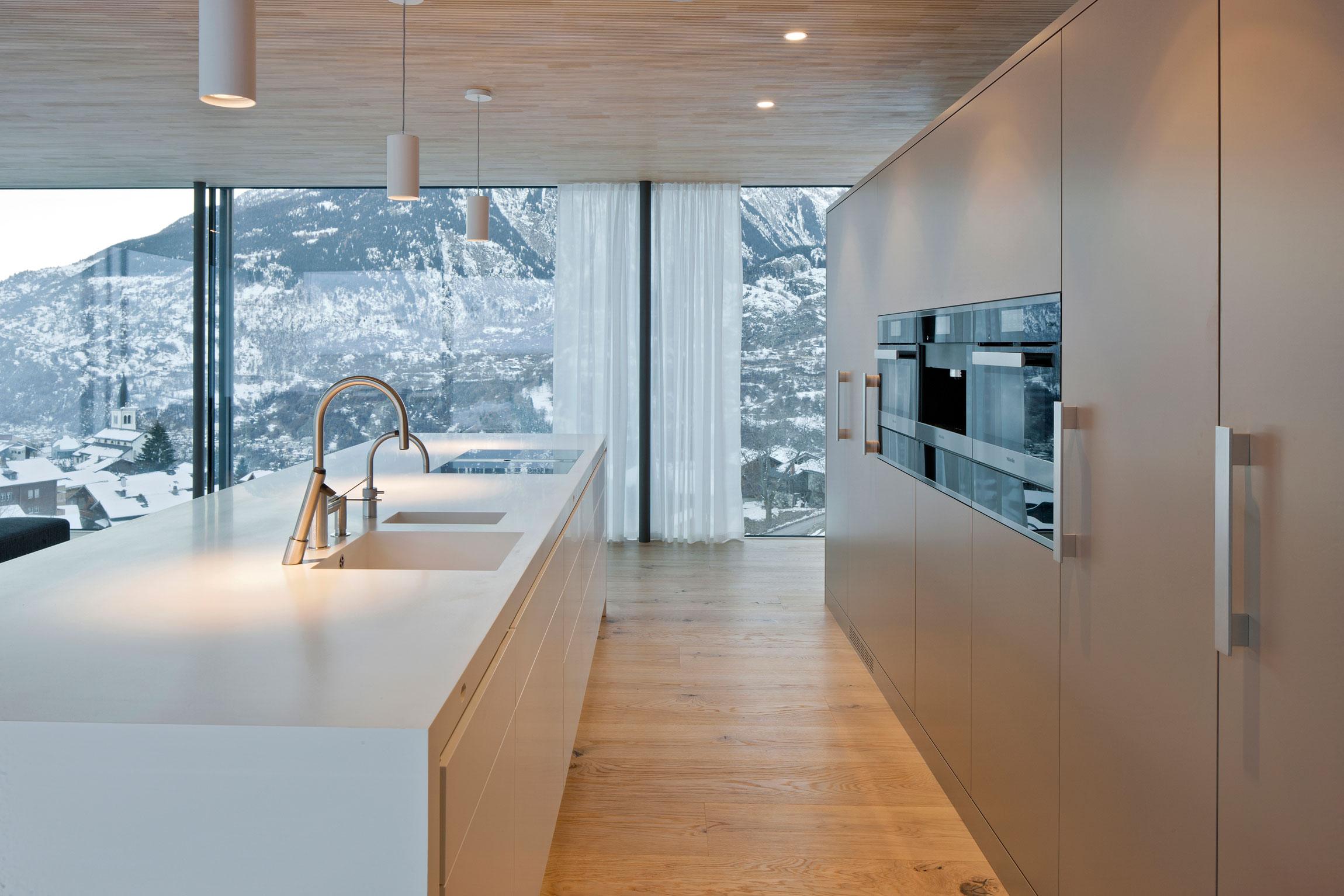 minergie house with hi macs kitchen in termen by zeiter berchtold caandesign architecture. Black Bedroom Furniture Sets. Home Design Ideas