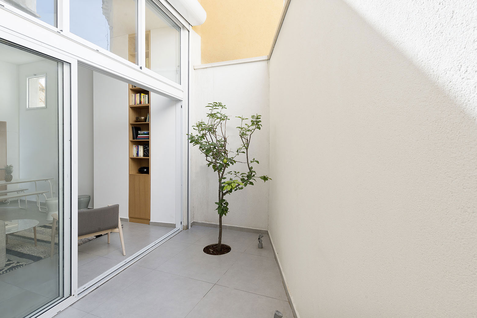 Adjusting a Mish-Mash of Small Rooms and Corridors into Jaffa Garden Apartment by Itai Palti-01