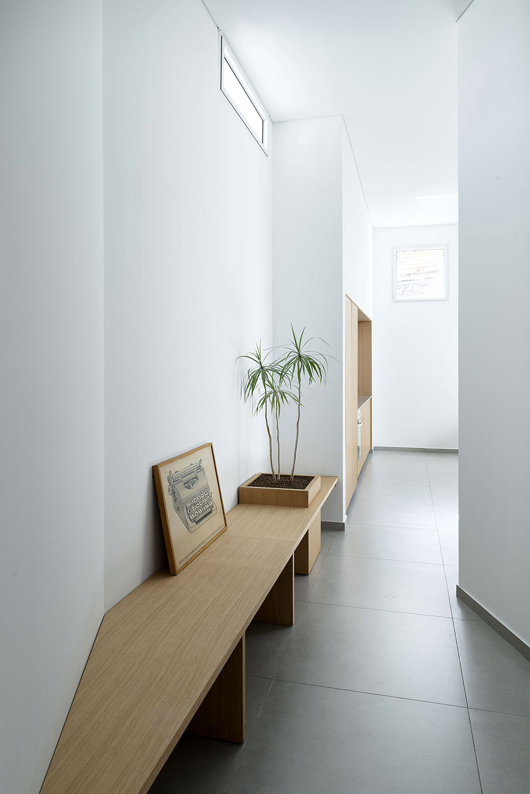 Adjusting a Mish-Mash of Small Rooms and Corridors into Jaffa Garden Apartment by Itai Palti-02