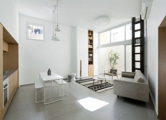 Adjusting a Mish-Mash of Small Rooms and Corridors into Jaffa Garden Apartment by Itai Palti