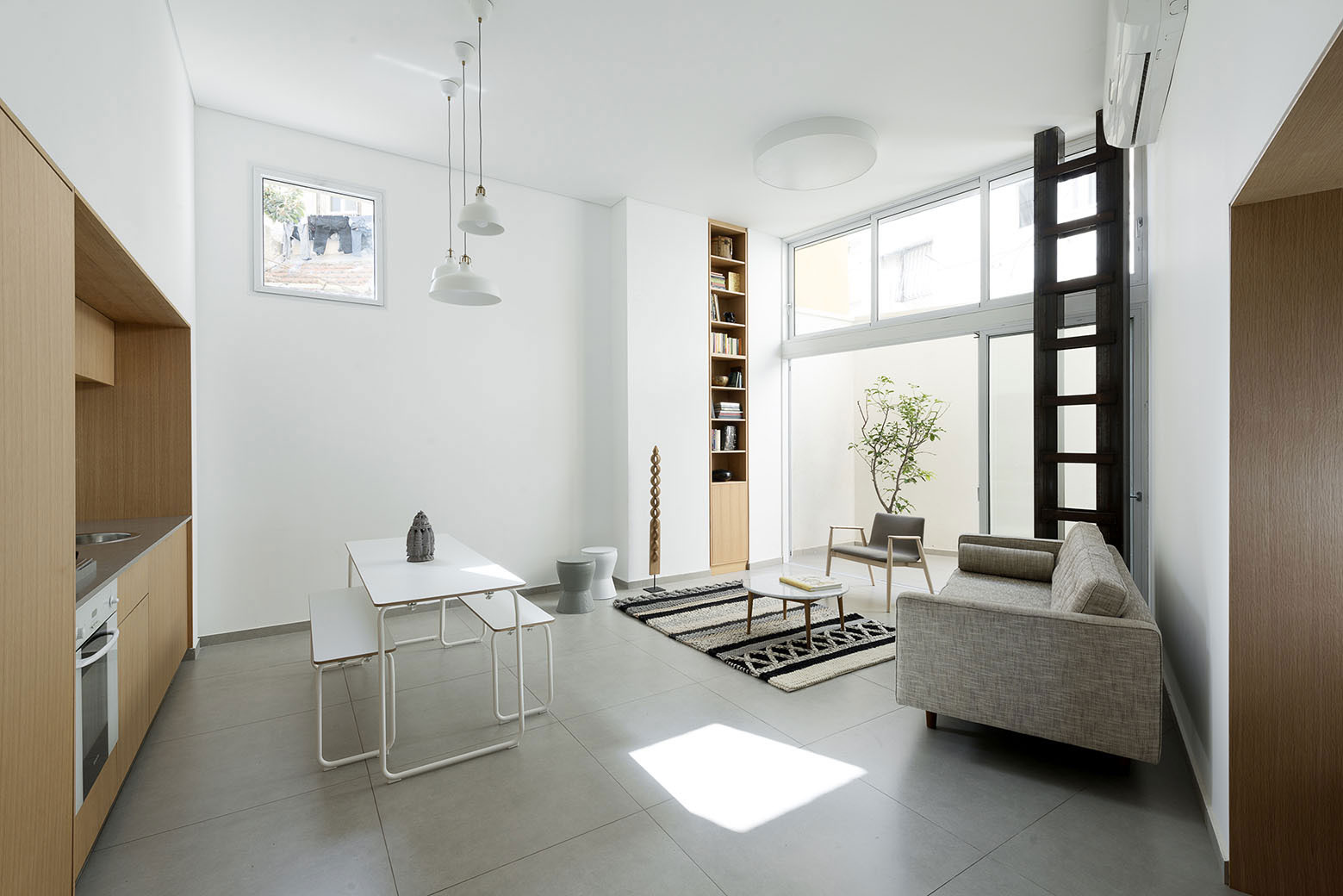 Adjusting a Mish-Mash of Small Rooms and Corridors into Jaffa Garden Apartment by Itai Palti-03