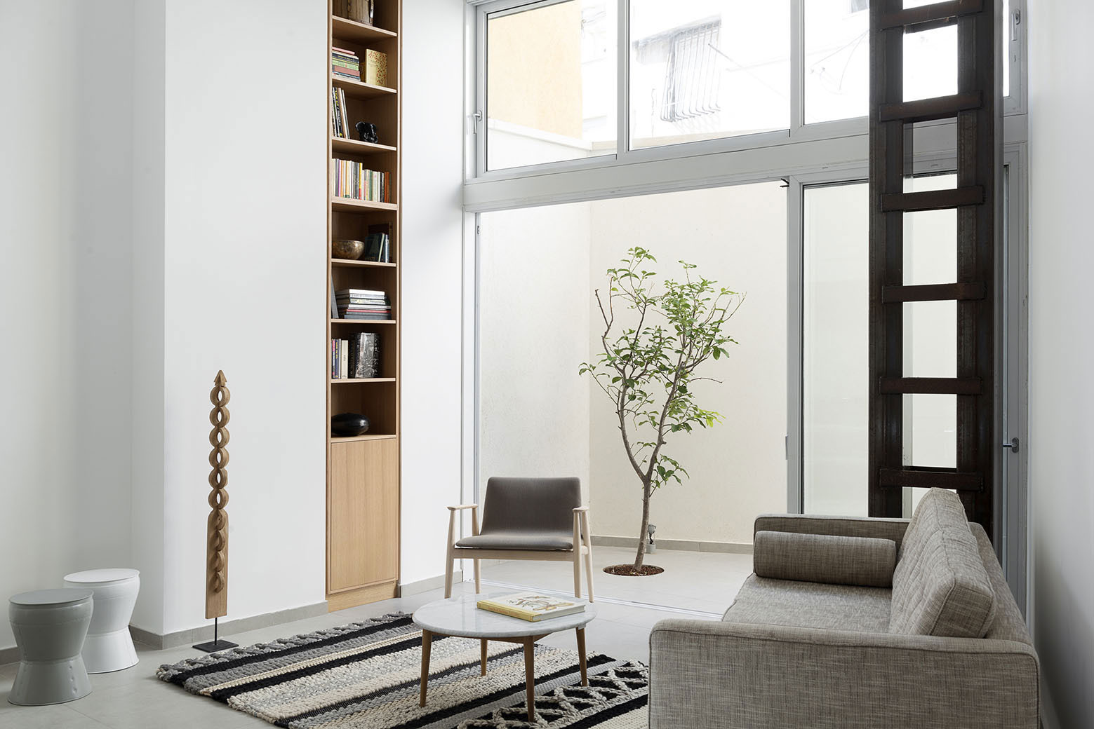 Adjusting a Mish-Mash of Small Rooms and Corridors into Jaffa Garden Apartment by Itai Palti-04