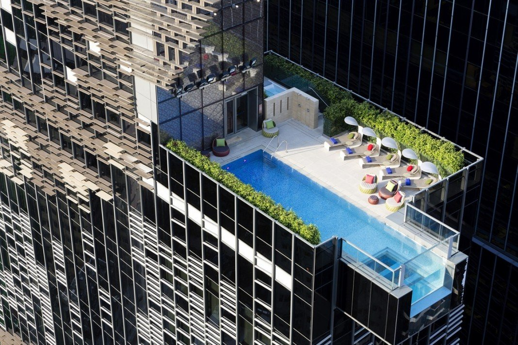 Aedas designed the Hotel Indigo in Hong Kong with a swimming pool that hangs out over the edge of the building