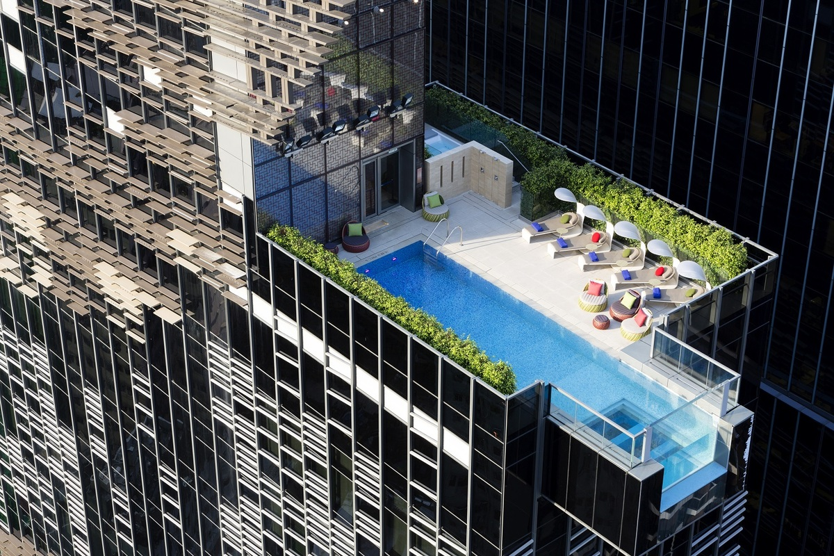 Aedas designed the Hotel Indigo in Hong Kong with a swimming pool that hangs out over the edge of the building-05