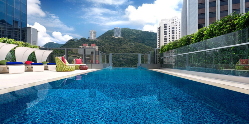 Aedas designed the Hotel Indigo in Hong Kong with a swimming pool that hangs out over the edge of the building-06