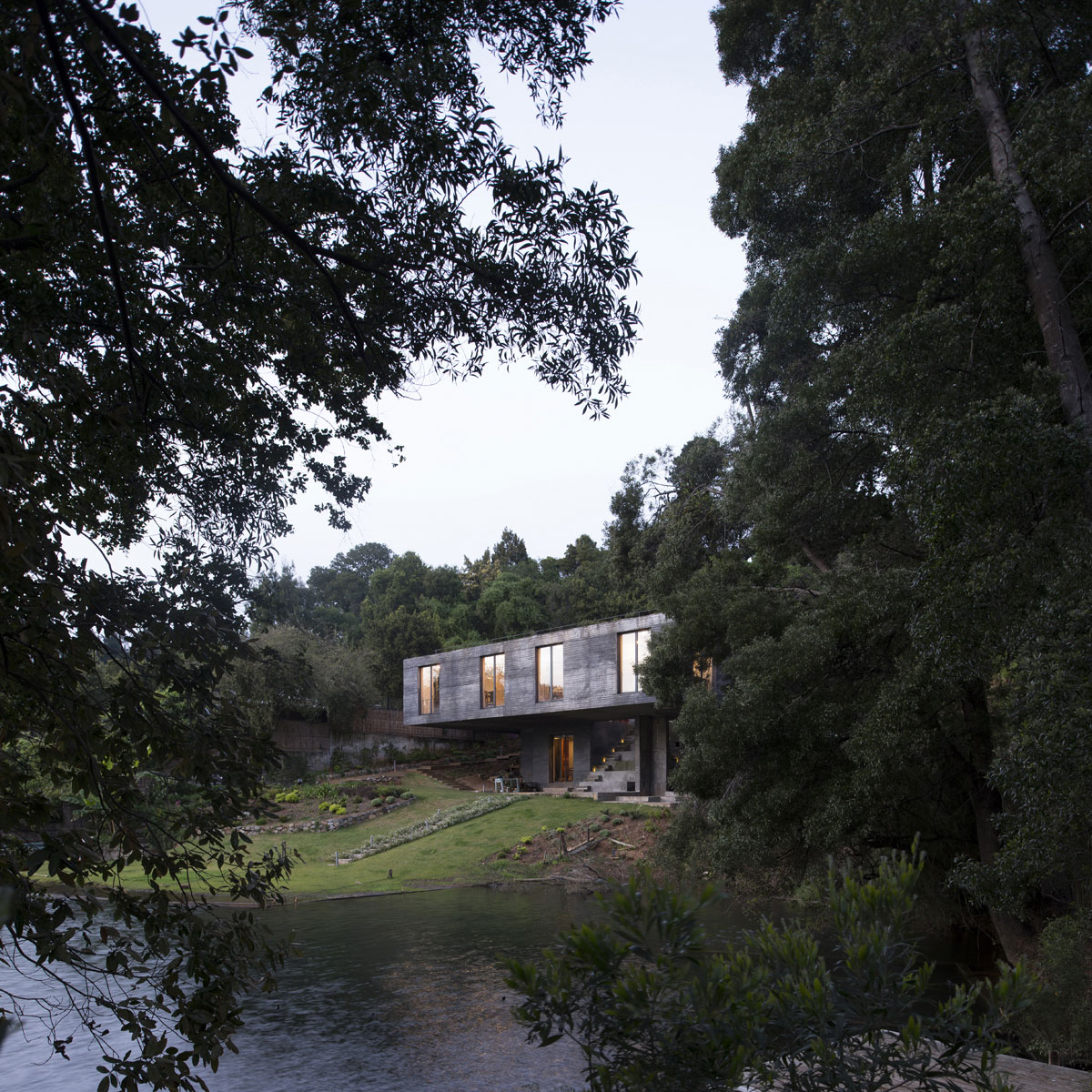 Guna House Located Between a Steeply Sloping Hillside and a Wood of Eucalyptus Trees by Pezo von Ellrichshausen-02