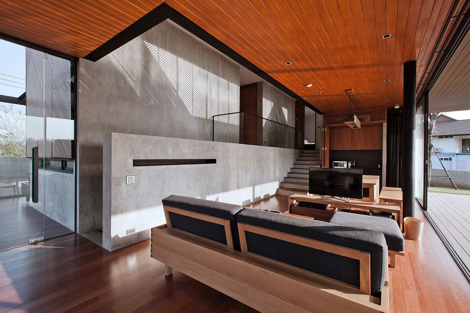 living room made by concrete and wood