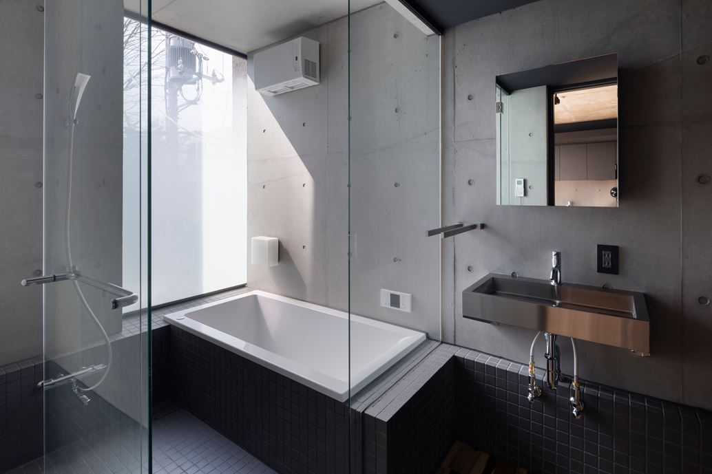 OKM 4 story building designed for a private residence and apartment in Tokyo by Artechnic-12