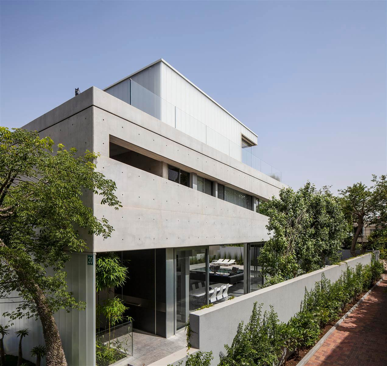 The Concrete Cut House in Ramat Gan by Pitsou Kedem Architects-05