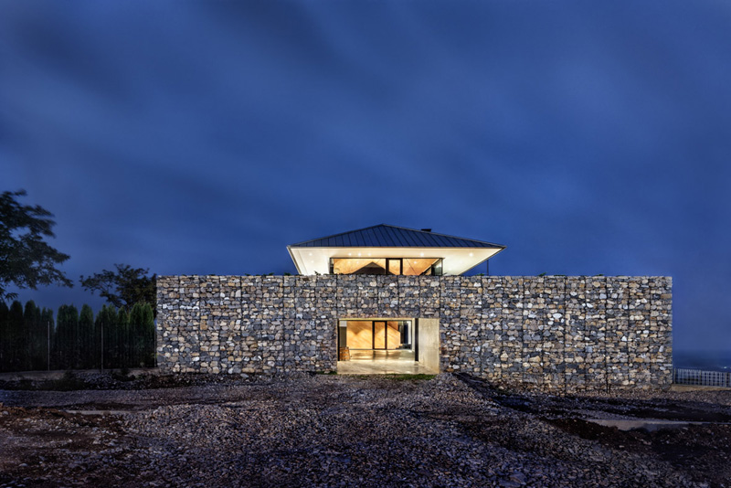 Walls made of gabion and awesome 360 degree views of Observation house by I O architects-02