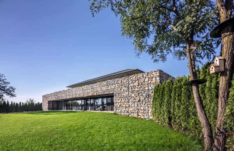 Walls made of gabion and awesome 360 degree views of Observation house by I O architects-03