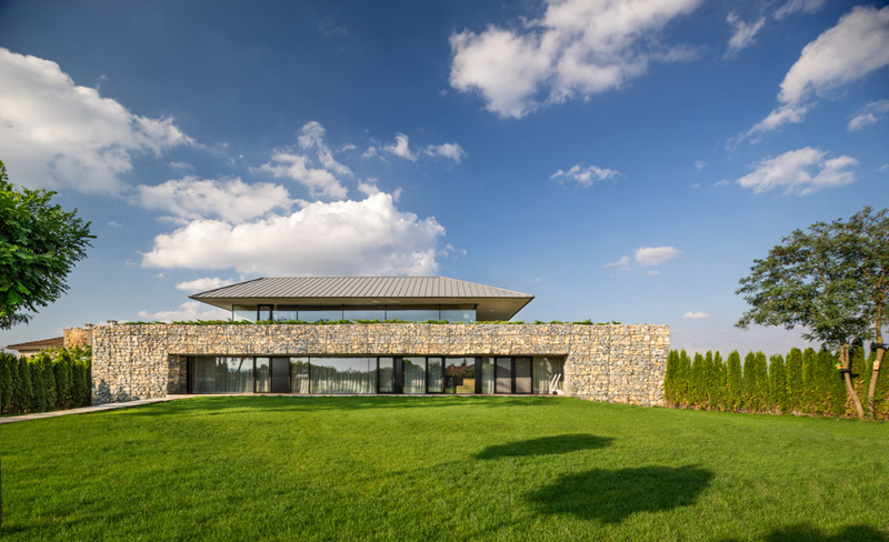 Walls made of gabion and awesome 360 degree views of Observation house by I O architects-05