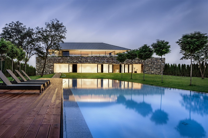 Walls made of gabion and awesome 360 degree views of Observation house by I O architects-06