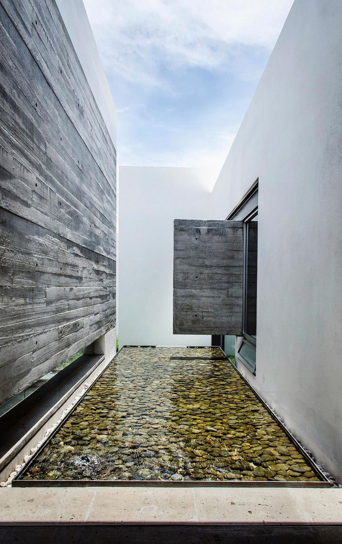 T02 house by adi arquitectura y dise o interior for Adi arquitectura y diseno interior