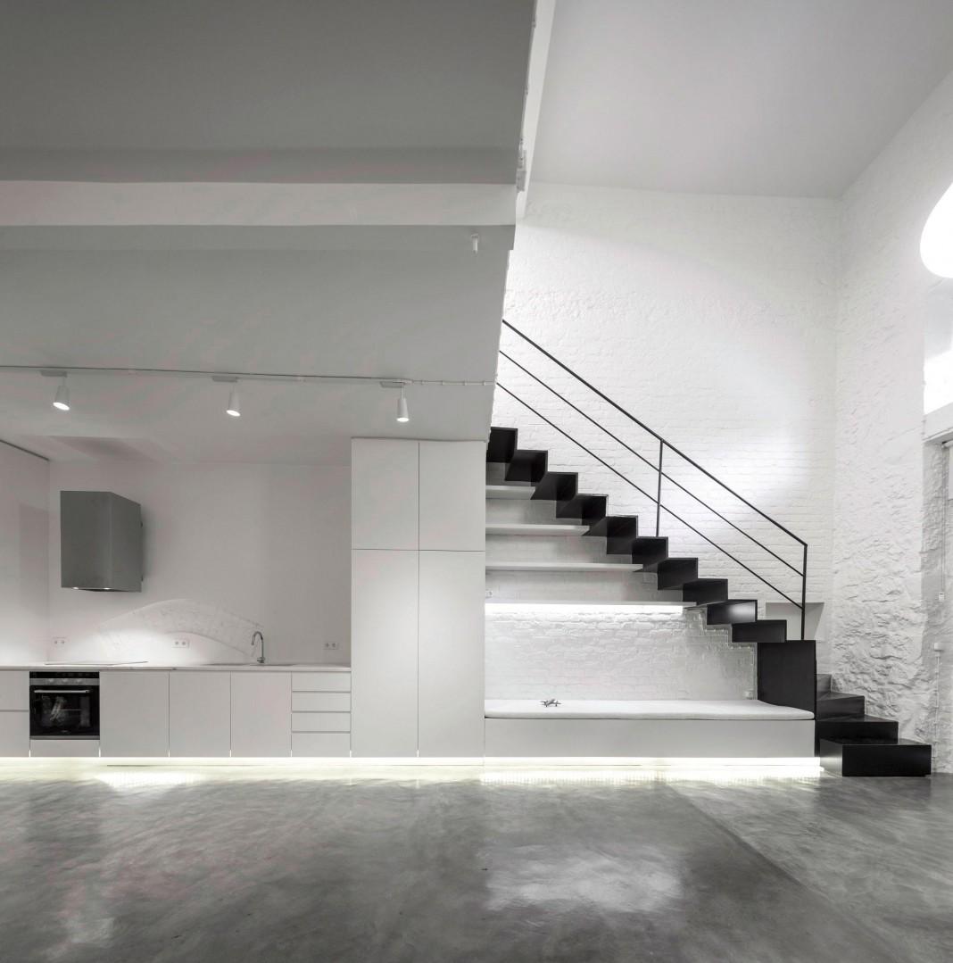 Minimalist Black and White Anjos Loft by João Tiago Aguiar