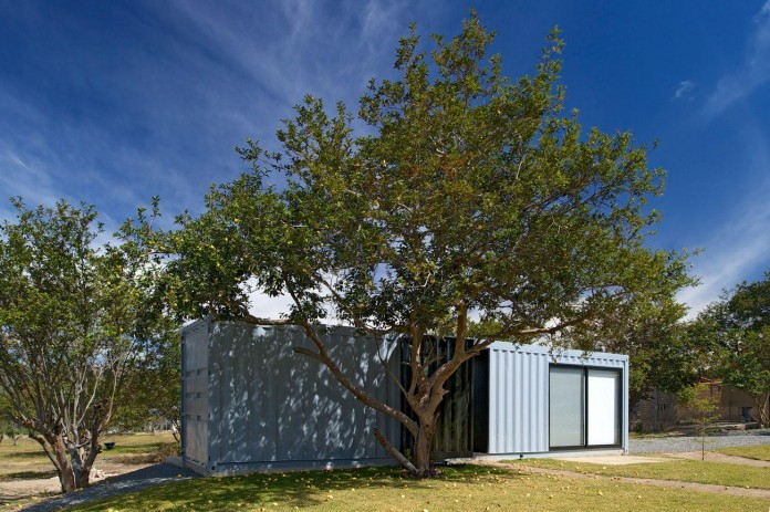 Huiini-House-made-of-four-shipping-containers,-located-in-the-Primavera-forest-by-S+-Diseno-01