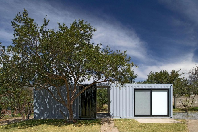 Huiini-House-made-of-four-shipping-containers,-located-in-the-Primavera-forest-by-S+-Diseno-02