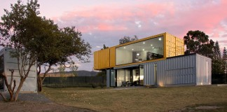 Huiini House made of four shipping containers, located in the Primavera forest by S+ Diseño