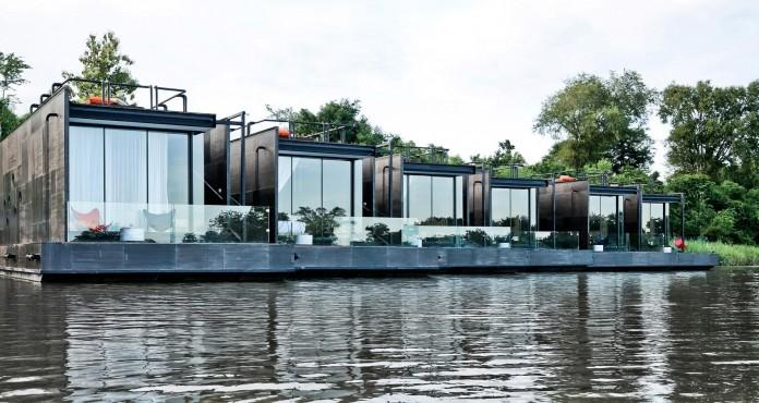 Lush-and-mountainous-landscape-of-X-Float-residences-on-River-Kwai-Bridge-by-Agaligo-Studio-01
