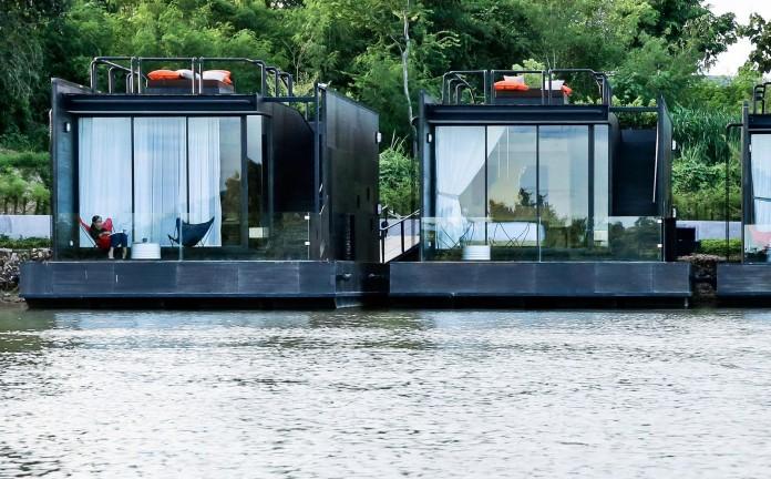 Lush-and-mountainous-landscape-of-X-Float-residences-on-River-Kwai-Bridge-by-Agaligo-Studio-03
