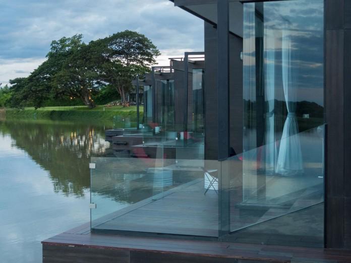 Lush-and-mountainous-landscape-of-X-Float-residences-on-River-Kwai-Bridge-by-Agaligo-Studio-04