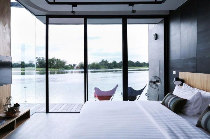 Lush-and-mountainous-landscape-of-X-Float-residences-on-River-Kwai-Bridge-by-Agaligo-Studio-12