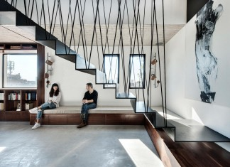 Wood, concrete and metal creates a contemporary yet warm living space of a Duplex Penthouse in Tel Aviv by Gabrielle Toledano