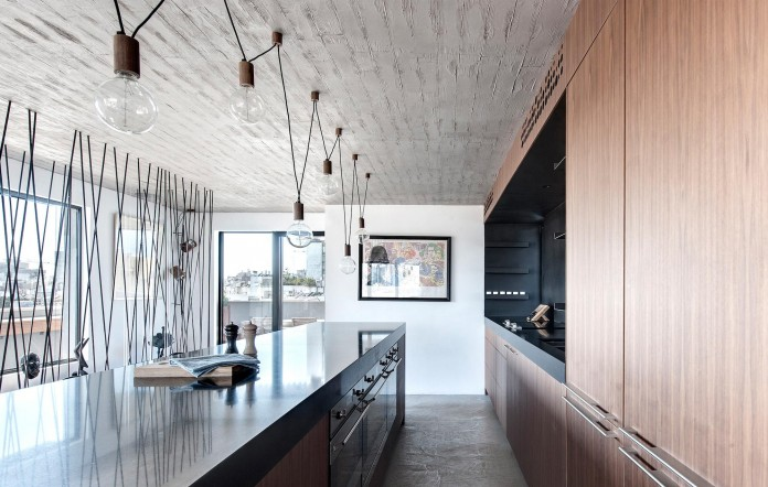 Wood-concrete-and-metal-creates-a-contemporary-yet-warm-living-space-of-a-Duplex-Penthouse-in-Tel-Aviv-by-Gabrielle-Toledano-13