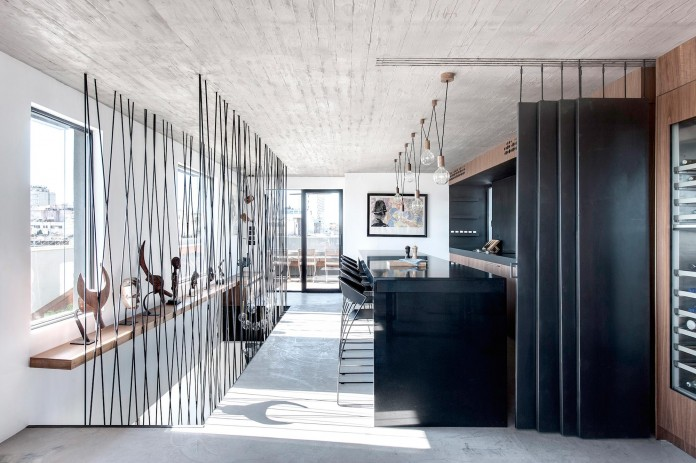 Wood-concrete-and-metal-creates-a-contemporary-yet-warm-living-space-of-a-Duplex-Penthouse-in-Tel-Aviv-by-Gabrielle-Toledano-15