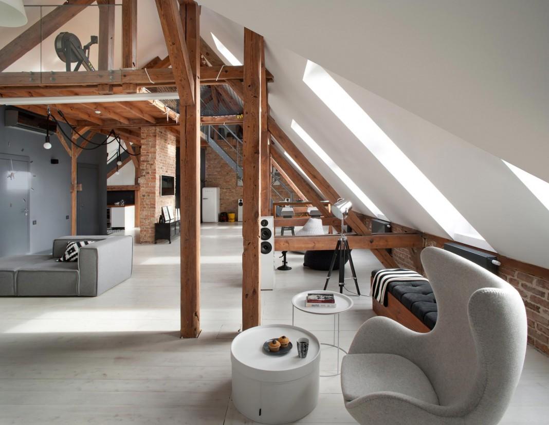 Contemporary attic apartment in the pozna city center by for Attic design studio