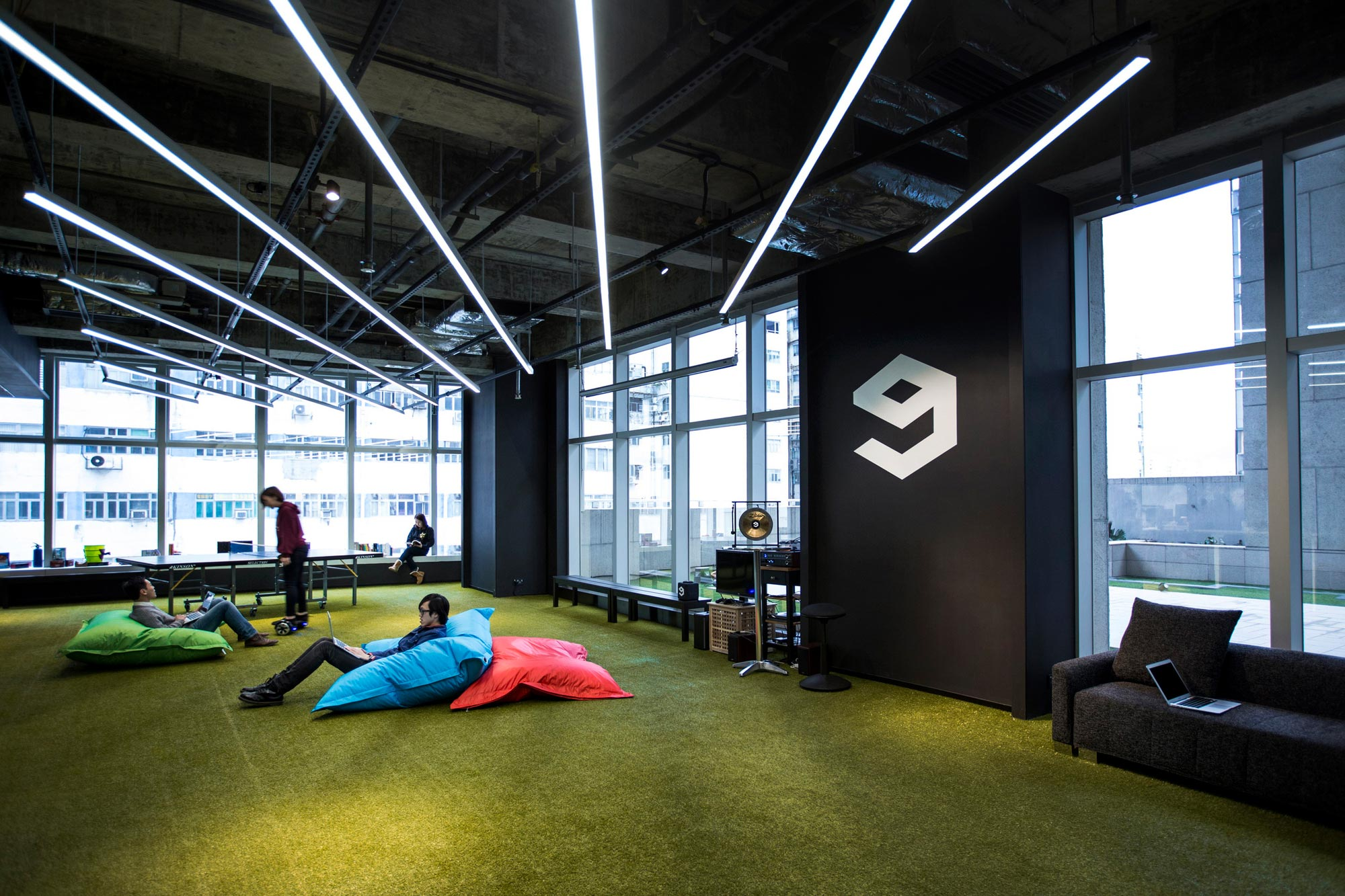 Minimalist black and white interior of 9gag office in hong for Woodworks design office 9