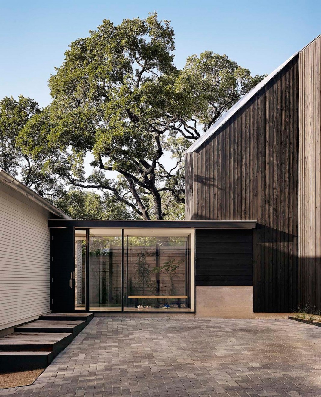 Renovation of an old bungalow into contemporary hillside for Hillside architecture