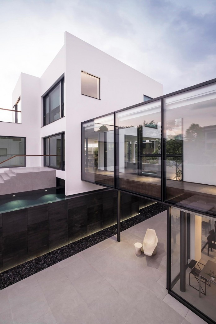 bridged-house-two-existing-houses-of-different-ages-and-styles-as-one-by-idabilly-architects-03