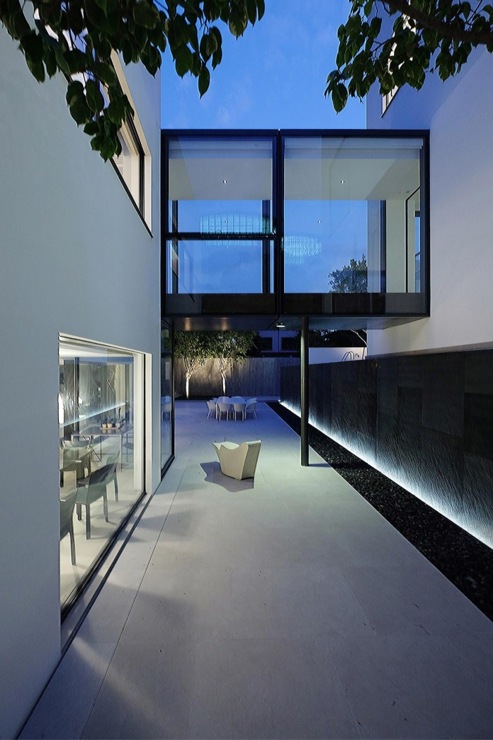 bridged-house-two-existing-houses-of-different-ages-and-styles-as-one-by-idabilly-architects-05